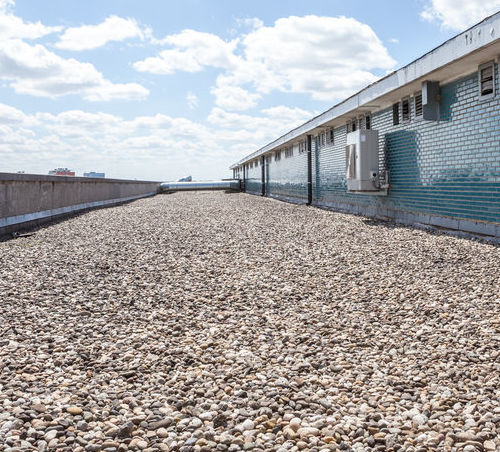 Traditional tar and gravel built up roofs are just one of many types of flat roofs.