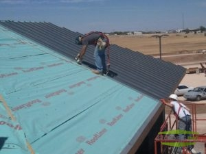 Picture of roofer working on commercial roof