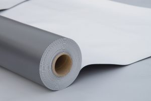A PVC Membrane Roll On a White Surface